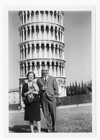 Well dressed couple in front of leaning tower Pisa,Italy, 1950