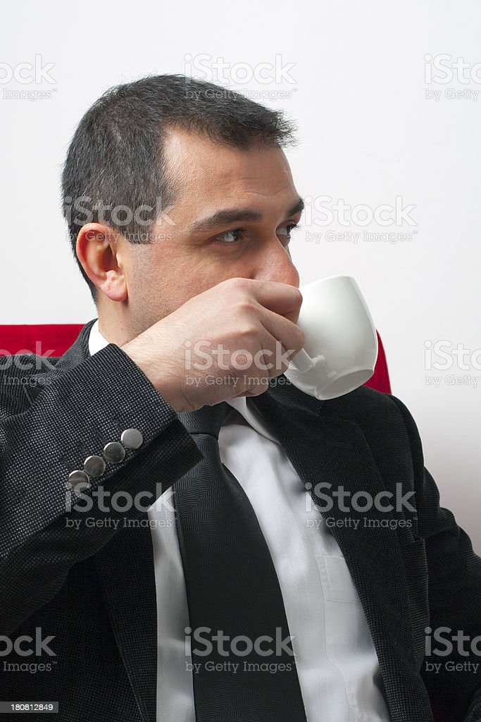 Well dressed man drinking coffee royalty-free stock photo
