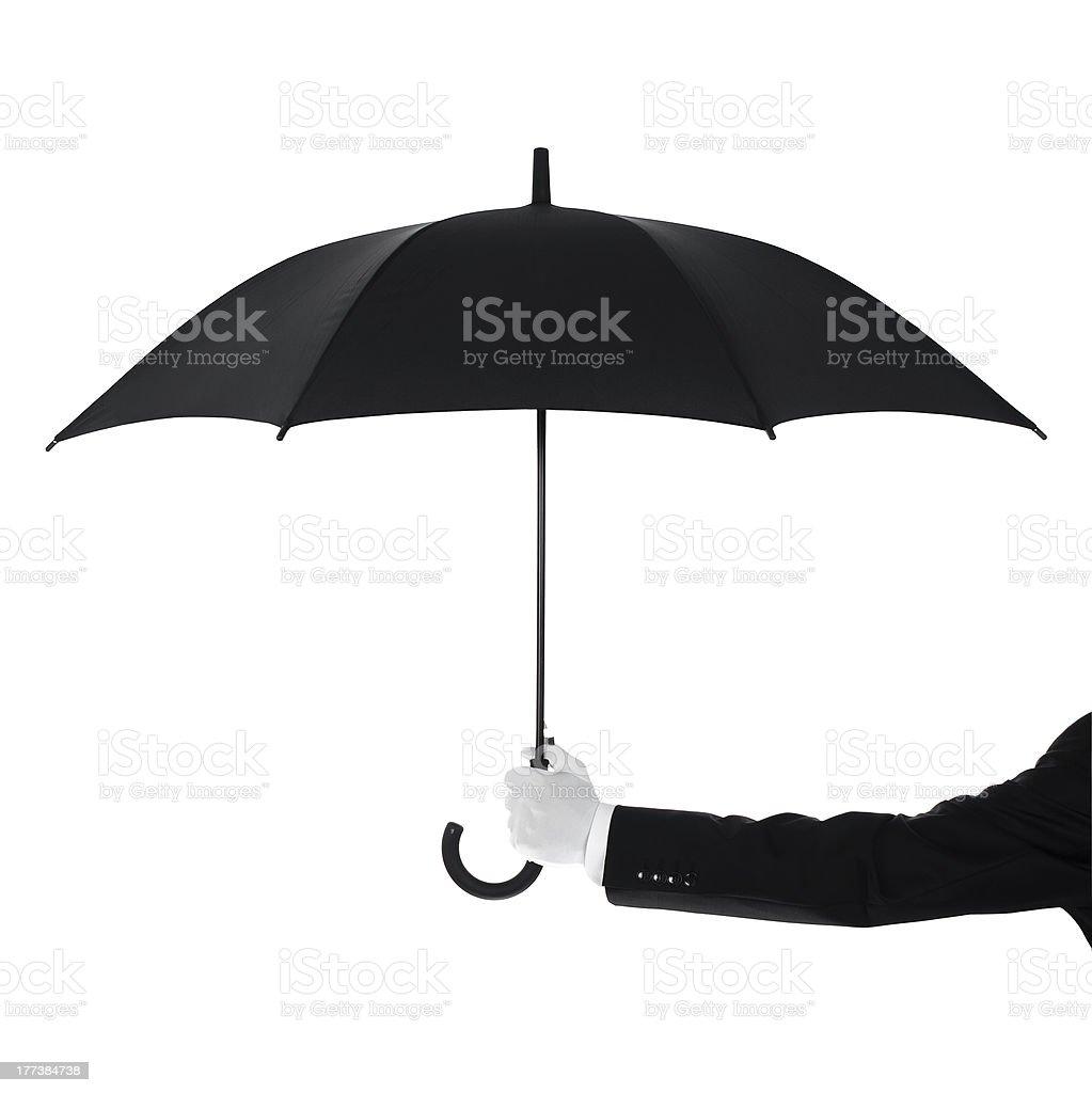 Well dressed man holding an umbrella stock photo