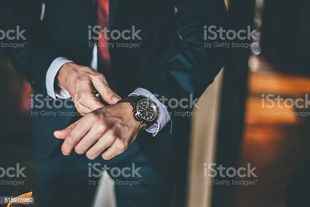 Well dressed man putting his wrist watch picture id515915980?b=1&k=6&m=515915980&s=612x612&h=tfaawtuvqblj1kntcpayp1bs4ifnnmoijyjroitenqg=