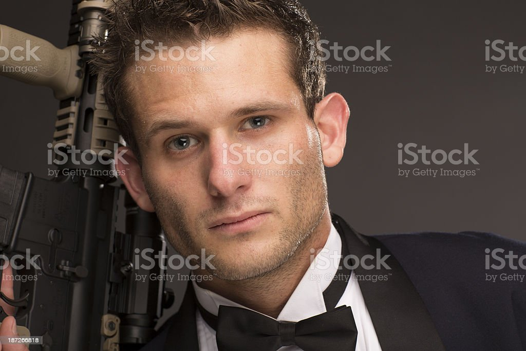 Well Dressed Man with AR 15 royalty-free stock photo