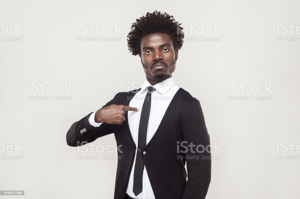 Well dressed proud man looking at camera with chesty face. stock photo