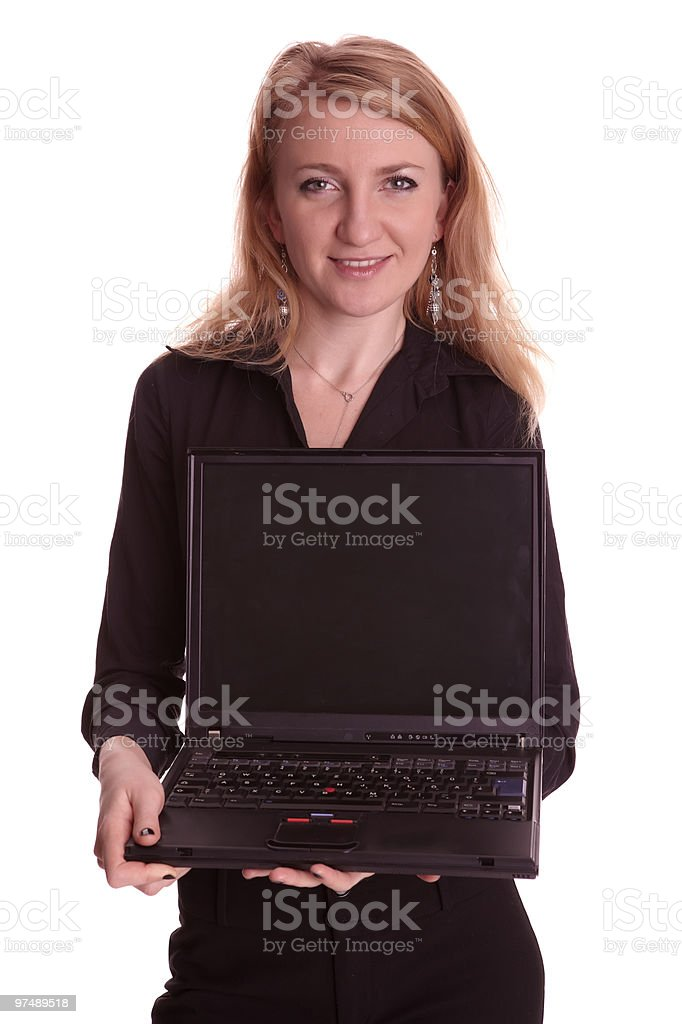 Well dressed woman shows blank screen of laptop royalty-free stock photo