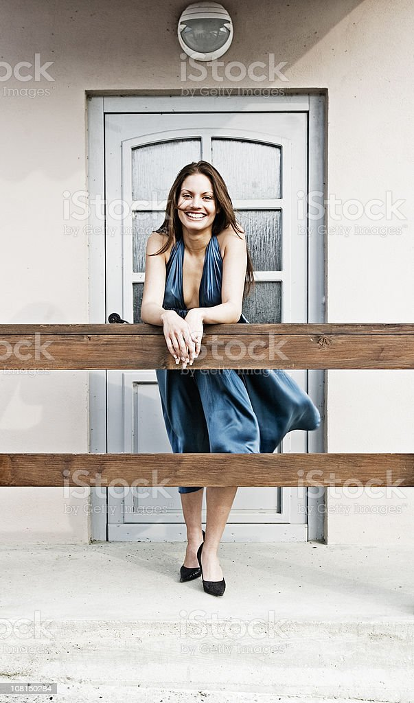 Well Dressed Woman Standing in Front of Door royalty-free stock photo