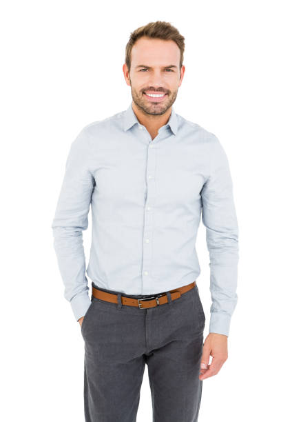 Well dressed young man smiling at camera stock photo
