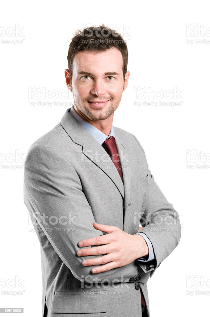 Well groomed business man in grey suit and red tie smiling royalty-free stock photo