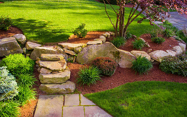 Well landscaped rock stairs and rock wall bildbanksfoto