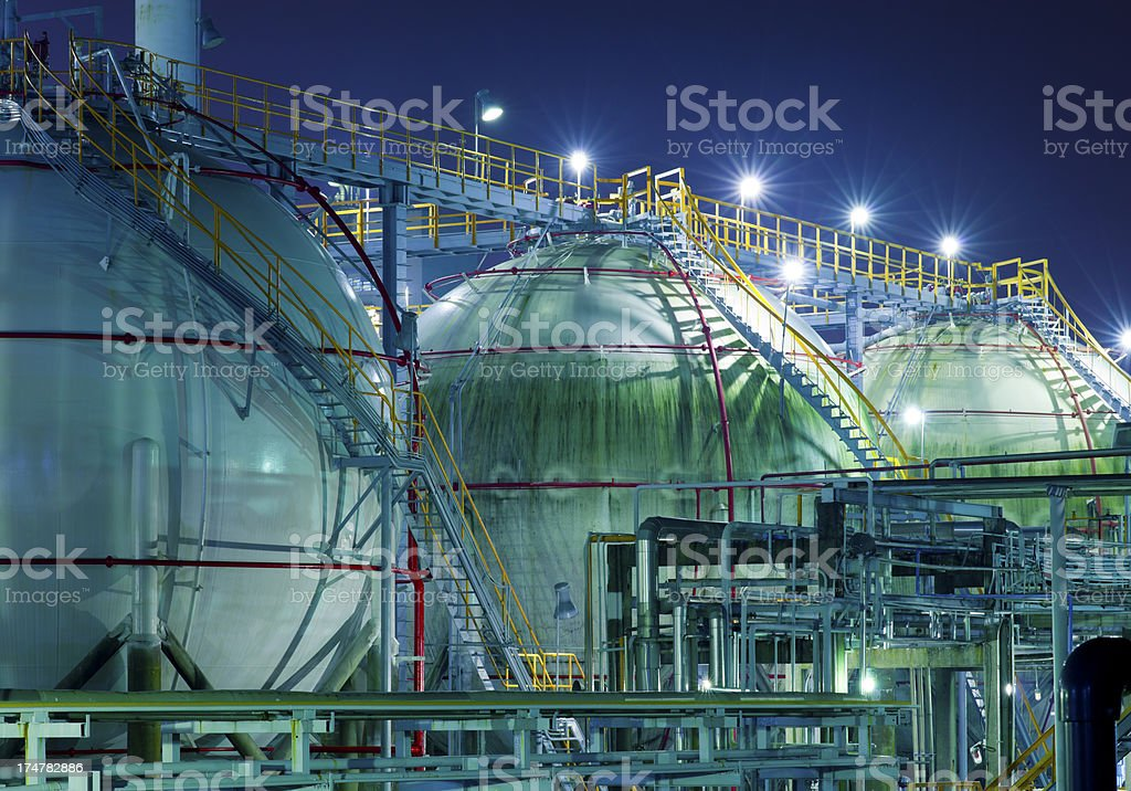Well lit chemical plant at night stock photo