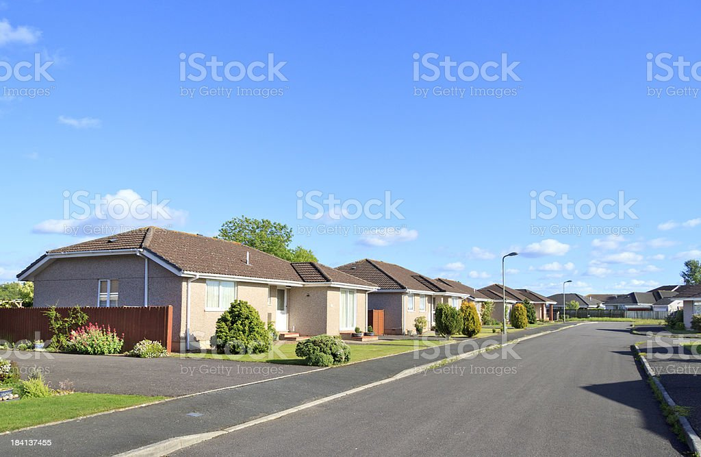 Well maintained street of similar bungalows stock photo