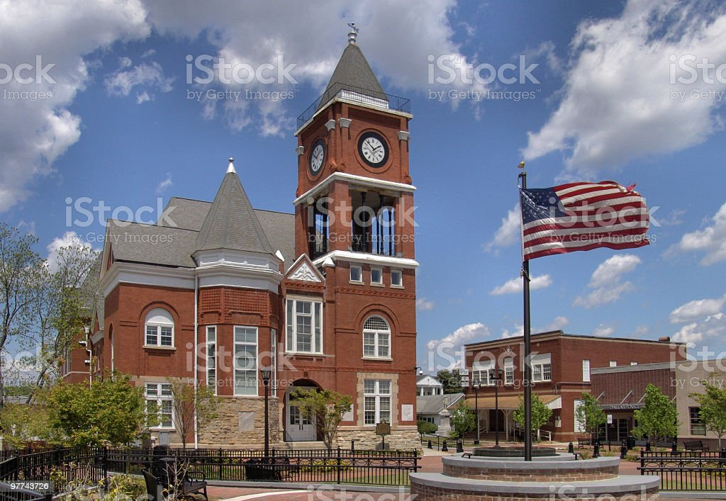 Well maintained town hall with a waving American flag stock photo
