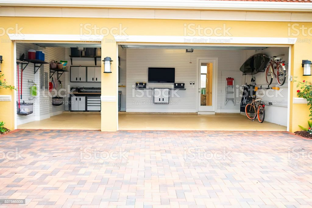 Well Organized Clean Three Car Residential Garage Royalty Free Stock Photo