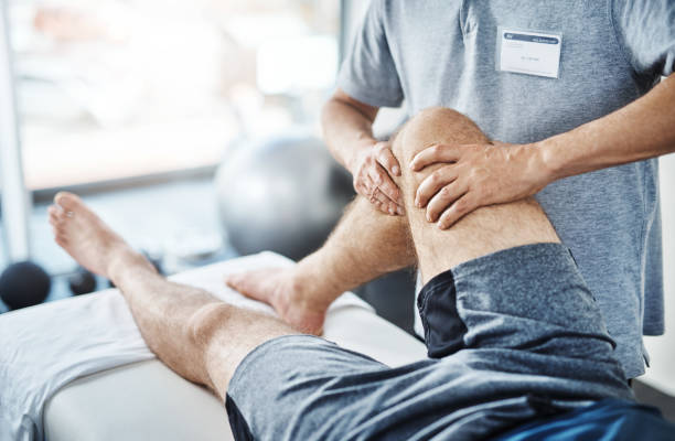 We'll sort out these sprains and strains Closeup shot of an unrecognizable physiotherapist treating a patient recovery stock pictures, royalty-free photos & images
