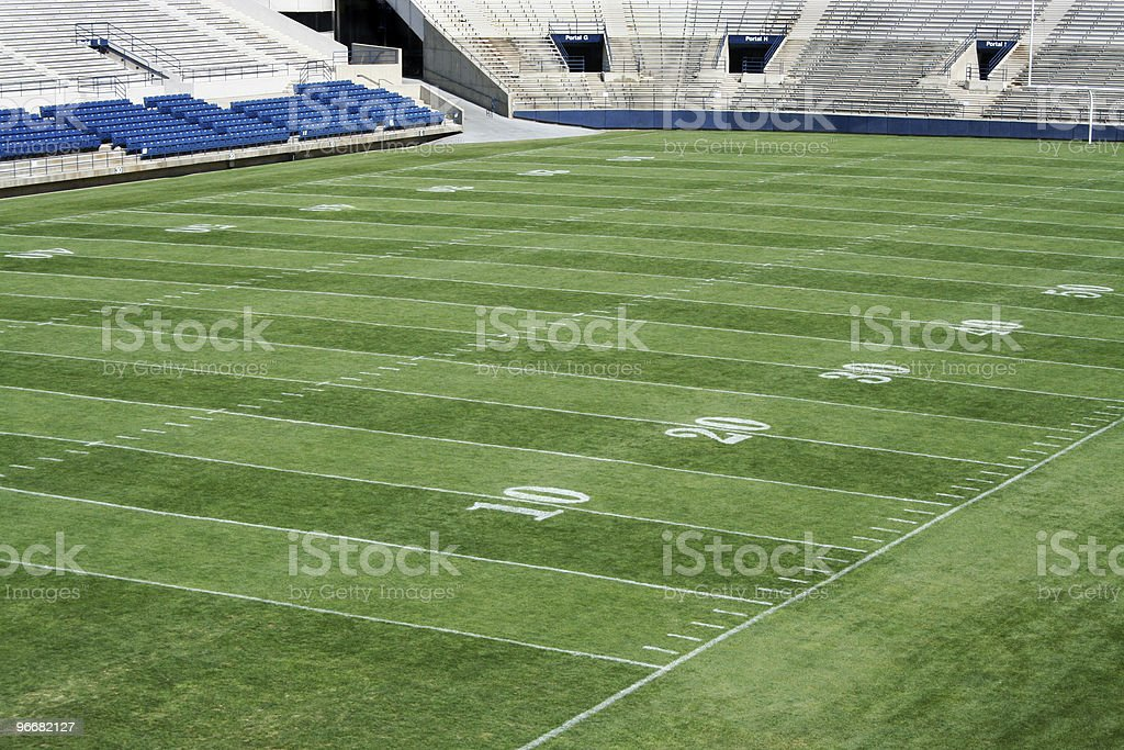 Well tended green football field in a stadium royalty-free stock photo