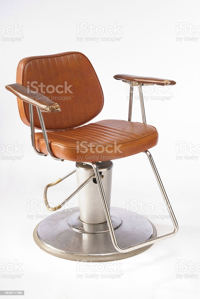 Well Used Barber Chair stock photo