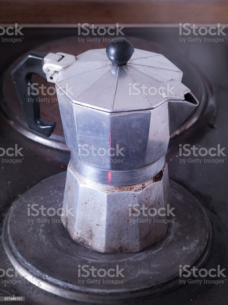 Well used espresso cooker on my electric plate stock photo