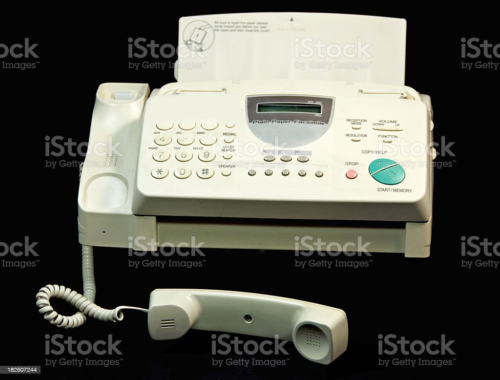 Well Used fax Machine on Black stock photo