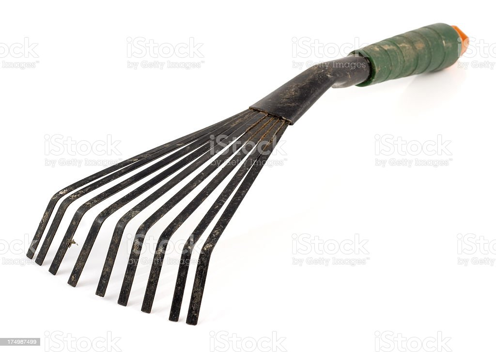 well used garden rake hand-tool royalty-free stock photo