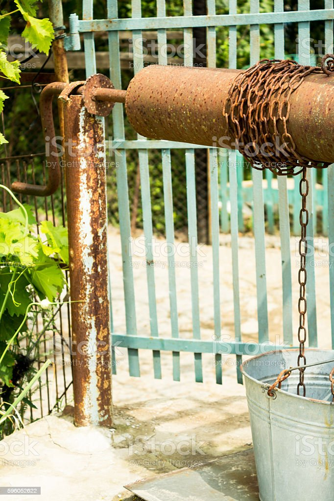 Well Water And A Bucket On A Chain Stock Photo - Download