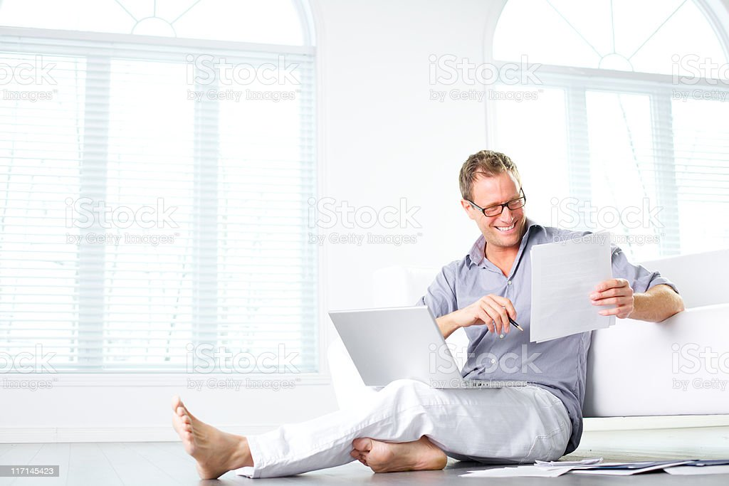 wellbeing man working at home royalty-free stock photo