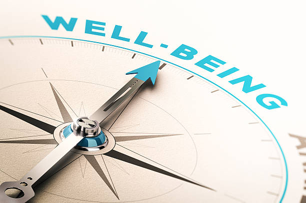 Well-being or wellness Compass with needle pointing the word well-being. 3D illustration with blur effect. Concept of wellbeing or wellness mental wellbeing stock pictures, royalty-free photos & images