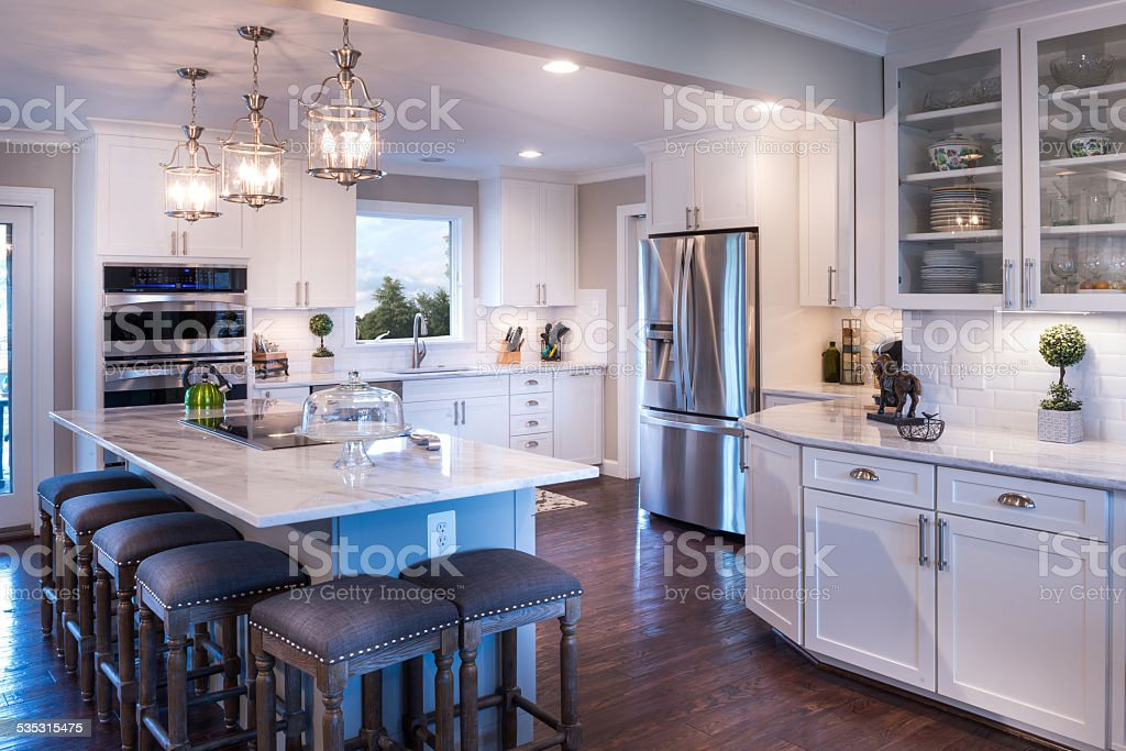 Well-designed white kitchen with white countertop stock photo