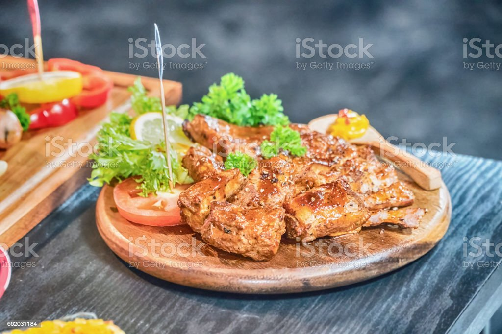 Well-done grilled marinated beef flank steak on wooden board royalty-free stock photo