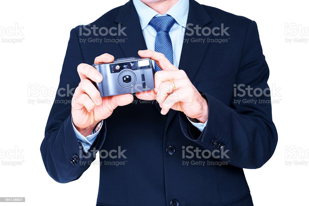Welldressed businessman taking picture with a camera royalty-free stock photo