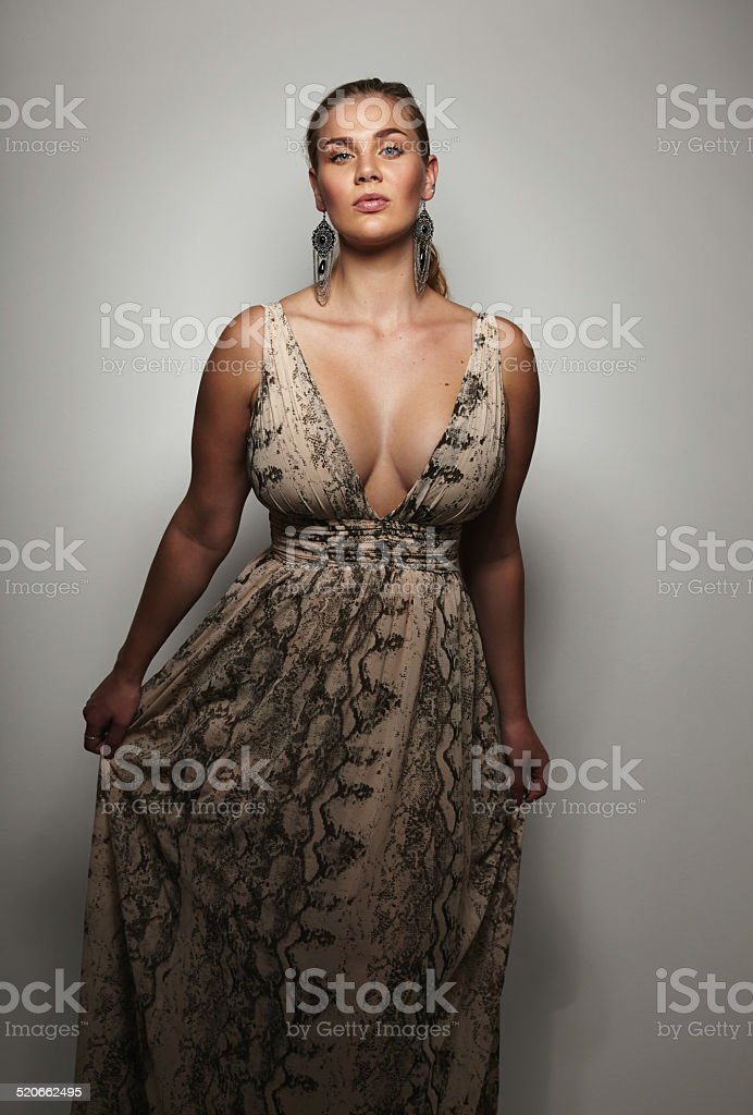 Well-dressed female model on grey background stock photo