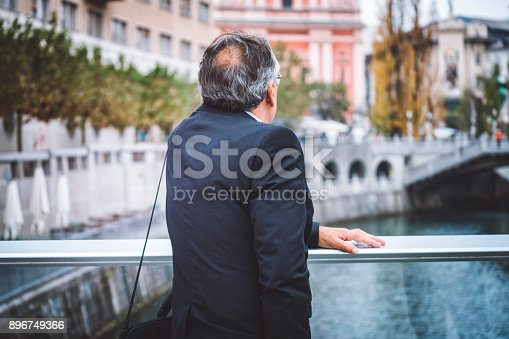 istock Well-dressed man enjoying his free time on the bridge 896749366