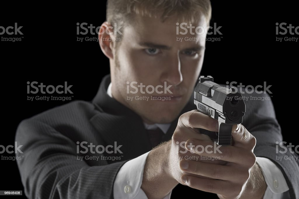 Well-Dressed Man With Gun royalty-free stock photo