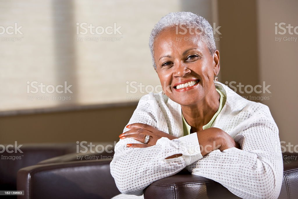 Well-dressed senior African American woman stock photo