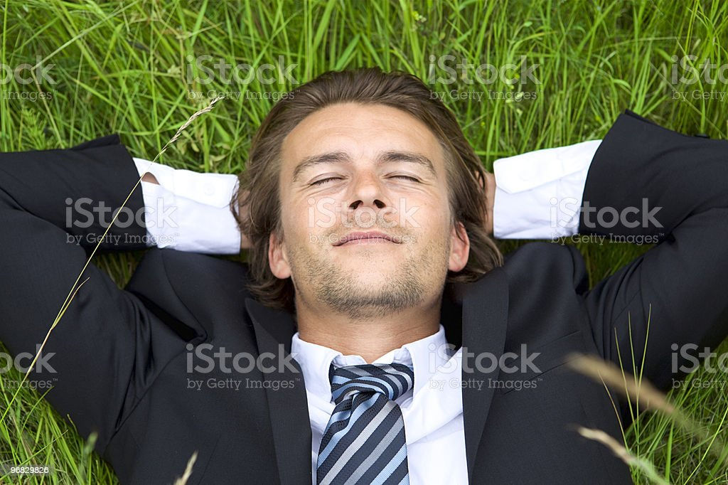 Well-dressed young businessman is resting stock photo