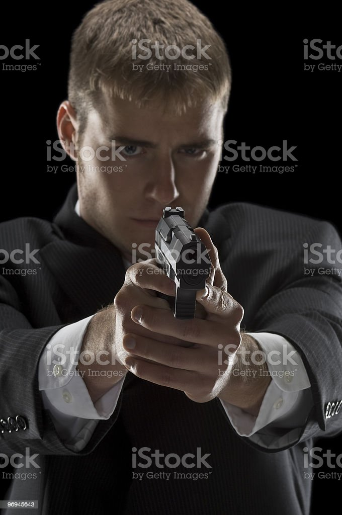 Well-Dressed Young Man Aiming Handgun royalty-free stock photo