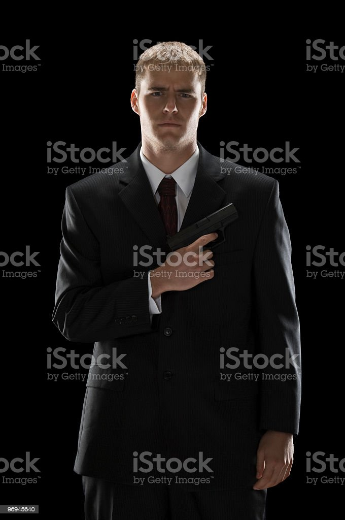 Well-Dressed Young Man With Gun royalty-free stock photo