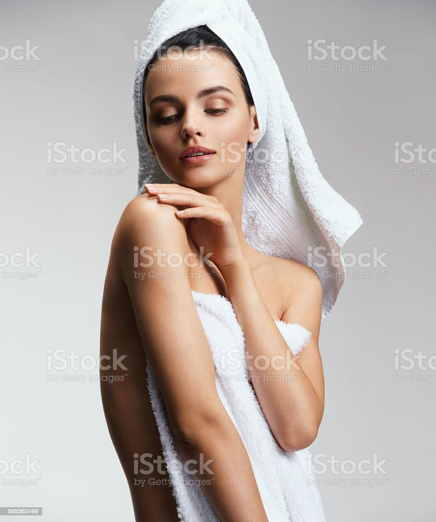 Well-groomed slim girl touching her shoulder stock photo