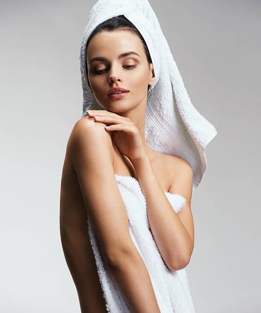 Well-groomed slim girl touching her shoulder stock photo