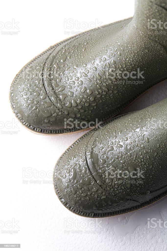 Wellington boots with raindrops stock photo