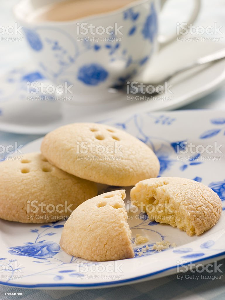 Wellington Button Biscuits with a Cup of Tea royalty-free stock photo