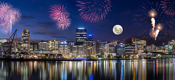 Wellington City at Night Wellington harbor cityscapes with full moon and fireworks wellington new zealand stock pictures, royalty-free photos & images