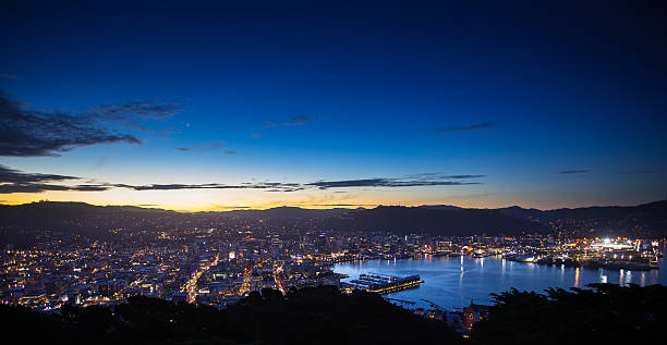 Wellington Harbour and City from Mount Victoria After Sunset Still from Getty time lapse video #625850288. View of Wellington from Mount Victoria at sunset. The sun has disappeared behind the hills, the sky is deepening to indigo and the lights of the city and the harbour shine on the water of the bay. mt victoria canadian rockies stock pictures, royalty-free photos & images