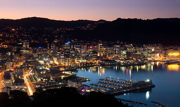 Wellington Harbour New Zealand's capital Wellington lights up at dusk. Seen from Mt Victoria. mt victoria canadian rockies stock pictures, royalty-free photos & images