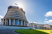 The Beehive Building, New Zealand's Parliament Building, against the Sun with Sunstars. Wellington, North Island, New Zealand, Oceania