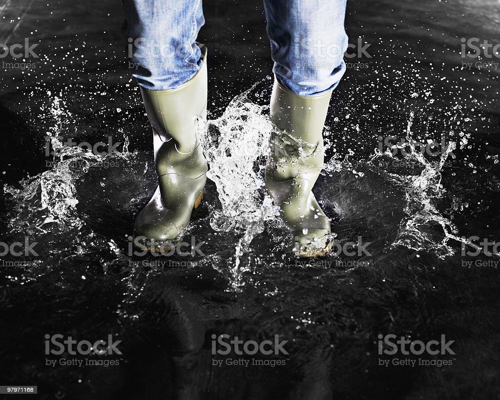 Wellingtons splashing in water royalty-free stock photo