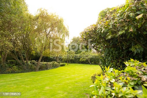 istock Well-maintained lawn and private gardens. 1281289520