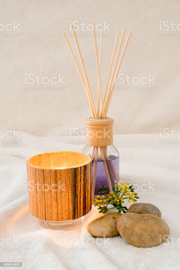 Wellness, aromatic oil with a decorative tealight and stones stock photo