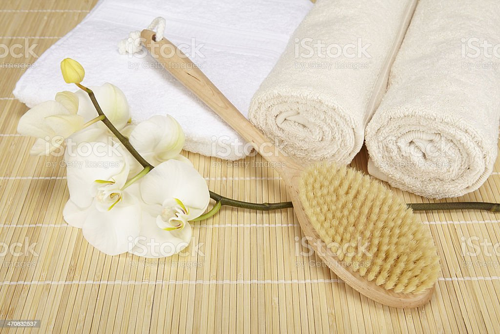 Wellness - bath brush, folded and rolled towels stock photo
