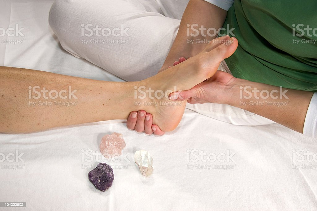 wellness composition - foot massage stock photo