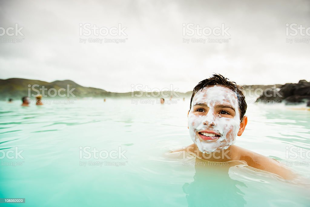 Wellness Geothermal Spa Happy Boy Smiling Face Pack stock photo