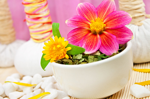 istock Wellness massage stamps and herbs 1203784298