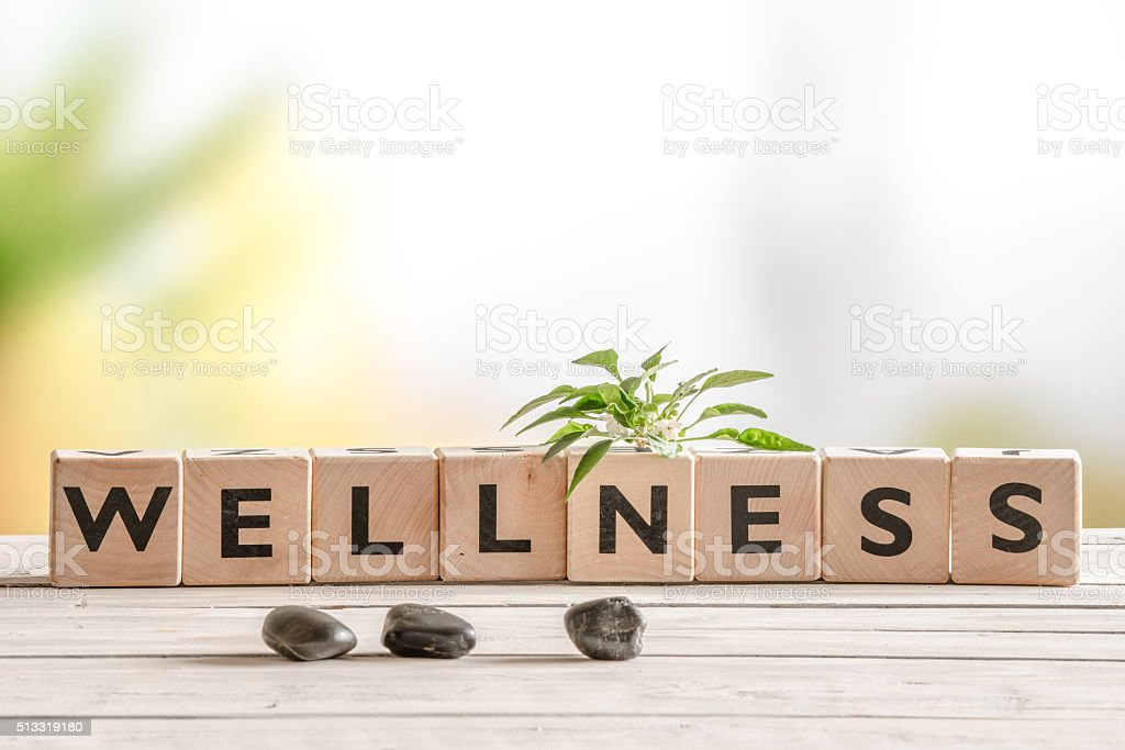 Wellness sign with wooden cubes Wellness sign with wooden cubes and flowers and stones Horizontal Stock Photo